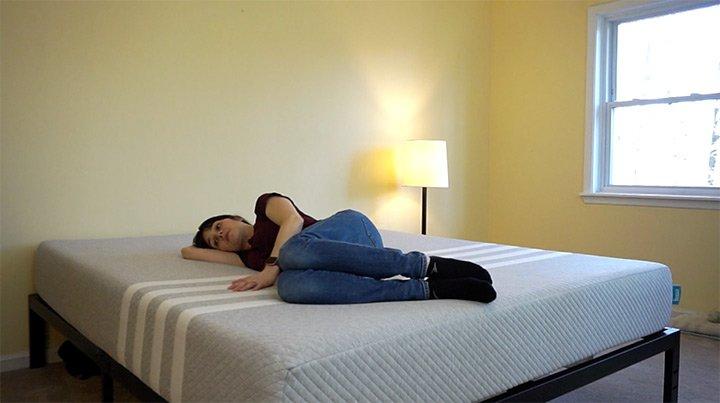 Woman Laying on side on top of Leesa mattress