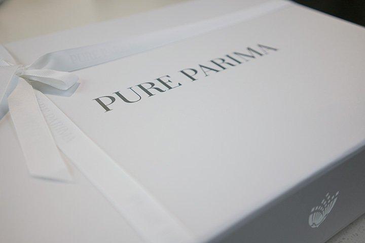 Pure Parima sheet review showing elegant white box with logo