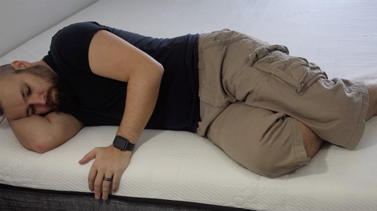 Man laying next to the edge of the Ecosa mattress